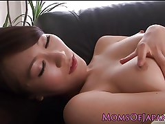 Japanese milf masturbating on couch