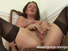 Dressed to the nines cougar Marlyn strips coupled with pleasures the brush hairy pussy