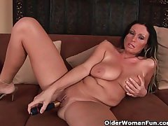 Big boobed soccer mom is toying her full-grown pussy