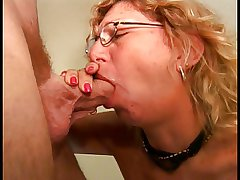 An old milf slut in glasses sucks a selfish blarney