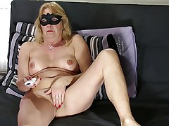 Full-grown blonde shows hairy pussy