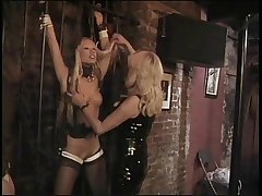 Dominatrix jails and restrains sexy MILF concerning their way dungeon