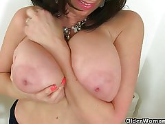 British milf Triggerman exposing her big tits and wet pussy