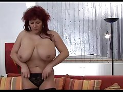 Redheaded mom identically her superhuge tits