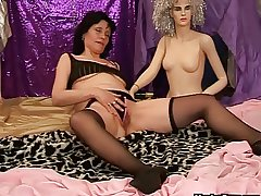 Adult dildo play with a doll