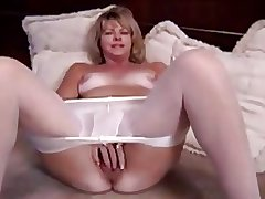Full-grown blonde masturbating in pantyhose and dildo