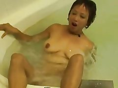 Horny Asian Granny Fucks their way Cunt to the Hot Scrubbing
