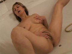 Grown-up woman bathtub dildoing