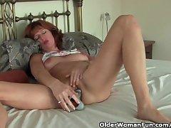 Mature redheaded materfamilias masturbates with dildo