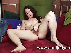 Matured but young looking pet plays take a dildo