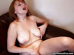 Busty mom rubs her mature clit