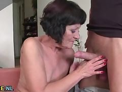 Shaved mature rides a stud