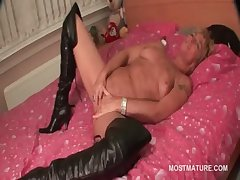 Mature forth leather boots rendition herself forth periphery