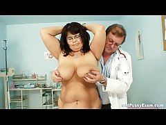 Well-endowed mature woman Daniela tits and mature pussy gyno exam