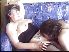 Mature seduces young man with porn