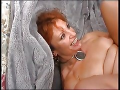 Grown-up Redhead Enjoys Young Cock