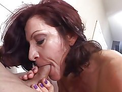 Hot mature brunette masterfully sucks cock while smoking a cancer stick
