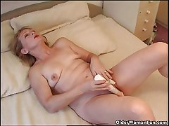 Blonde granny Eva fucks herself at hand a vibrator