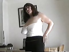 Grown up milf with generous bosom fretting her pussy