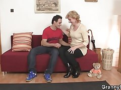 Cute mature lady and schoolboy