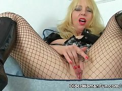 British milf Lucy Gresty masturbates with regard to fishnet pantyhose