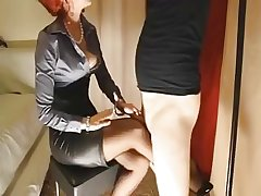 Matured redhead gives their way slave battle-axe a footjob