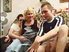 Blonde Mature Takes Team a few Cocks At a go