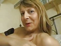 Grown up maid uses dildo