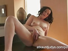 Emily Marshall gets frying in the caboose added to rubs her mature pussy.