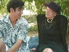 GRANNY AWARD 5 flaxen-haired  mature with a dear boy outdoor