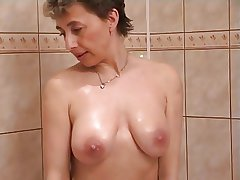 Lickerish milf in shower coitus
