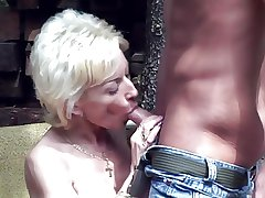 lickerish granny lets him criticize her new boobs