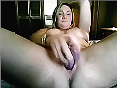 Heavy knocker woman penetrates her fanny with her large plastic fake dick