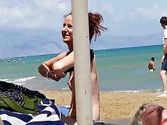 Indulge caught topless in Agia Marina, Creta.