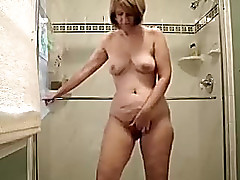 Older golden-haired wife in the baths masturbating essentially web camera