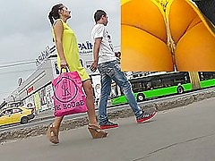 Hot upskirts with slender brunette with yellows dress