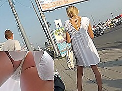 Tight ass of along to young blonde caught on along to upskirt cam