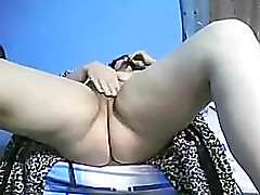 Shameless large entrancing woman darksome brown rubs her trickling wet trench