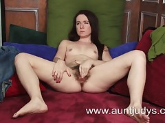 Full-grown looking babe plays with a dildo