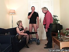 Horny granny takes two cocks handy once