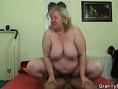 Big titted granny tastes yummy cock
