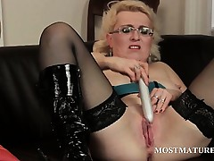 Mature connected with glasses vibrating her big snatch