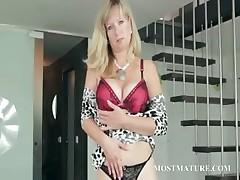 Grown up blonde hottie stripping sensually