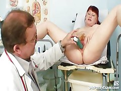 Mature Olga has her redhead hairy pussy gyno speculum examined by gyno dilute