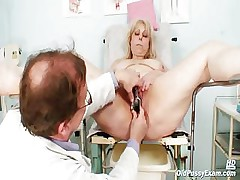 Big boobs mom gets her both holes properly checked away from a odd gynecologist