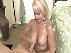Milf blonde tugging cock over her tits and wanting cum