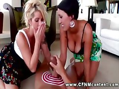 Brunette busty lady sucks and ride cock while her blonde friend plays with her pussy