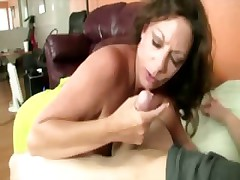 Naughty milf loves the feeling of his cock in her hands