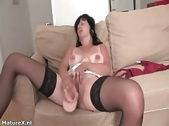 Roasting mature gloom woman sucks dildo