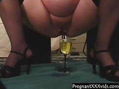Pregnant Wife fills a glass concerning piss